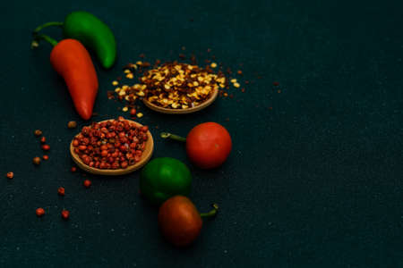 Cooking concept with hot chilli pepper on stone background with copy space