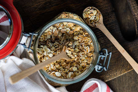 Healthy food concept with oats meal on dark rustic background with copyspace