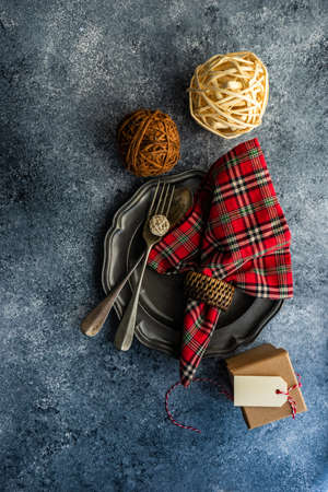 Table setting for festive Christmas dinner on stone table with copy space Stockfoto