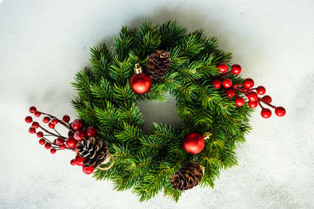 Decorated Christmas wreath on the stone background with copy space