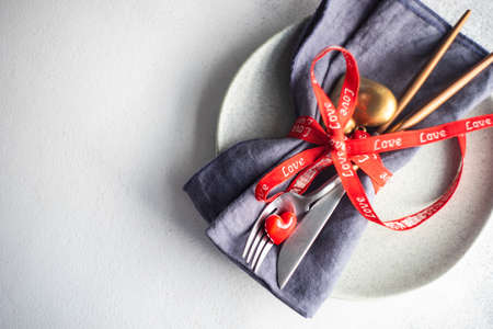 Table setting for St. Valentines day dinner on stone background with copy space