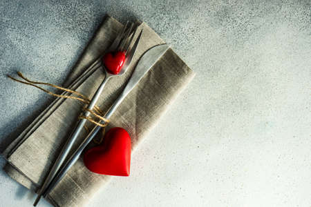 Cutlery set with hearts on stone background with copy space 스톡 콘텐츠