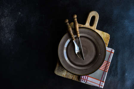 Empty bowl as a table setting concept on stone background with copy space