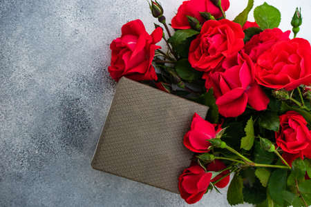 Fresh red roses on concrete background with copy space as a gift card concept Archivio Fotografico
