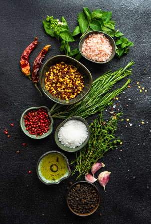 Variety of spices and herbs as a cooking frame on stone background with copy space Reklamní fotografie