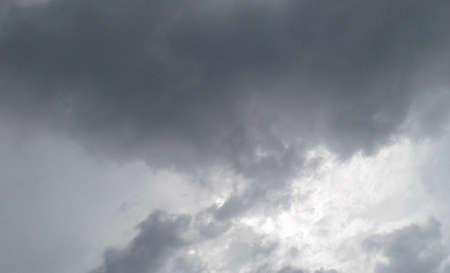 最小光と重い雲と大空 写真素材