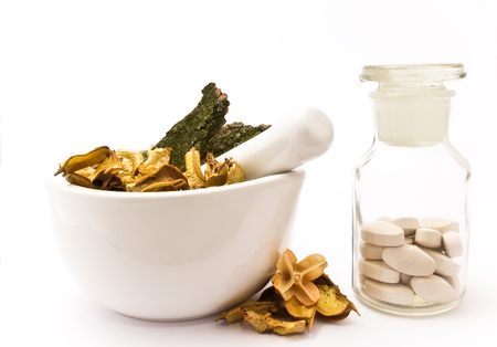 therapeutics: White mortar and pestle. Herbals, pills and pharmacy bottle.