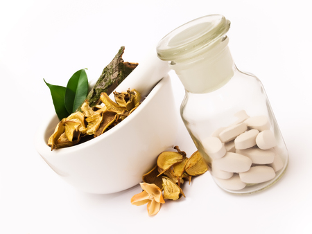 White mortar and pestle. Herbals, pills and pharmacy bottle. photo