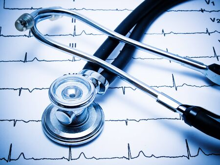 heals: Stethoscope and ECG chart. Blue ink. Stock Photo