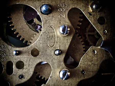 Clockwork, gears and screws. Mechanical structure. Stock Photo
