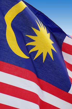blowing of the wind: Malaysian flag blowing wind. Close-up. Outdoor shot, postproduction.