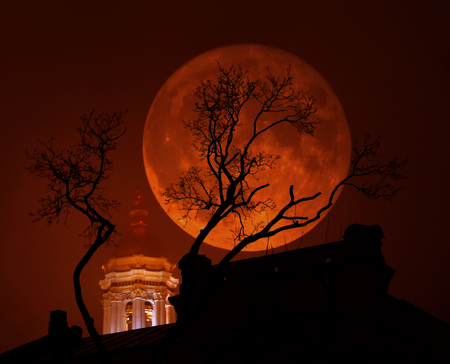 Supermoon, a rare astronomical full moon phenomenon. Moon is bigger as normal in the sky. Photo illustration with double exposure.