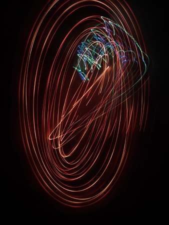 A photo taken by the camera in free flight, Bright colored lines and figures on black. Flyfly. Camera toss image Stock Photo