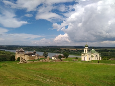 Panorama of the Khotyn fortress, the large-format picture, old building, middle ages, the church, the dramatic sky, clouds, fantastic landscape, defensive structure, is in valley, like the Lost World