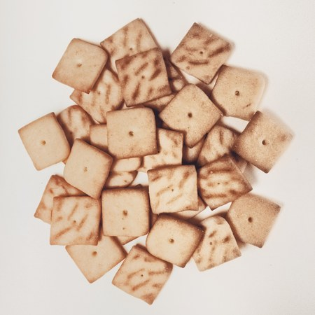 cookies crackers isolated on white background, macro, on light gray
