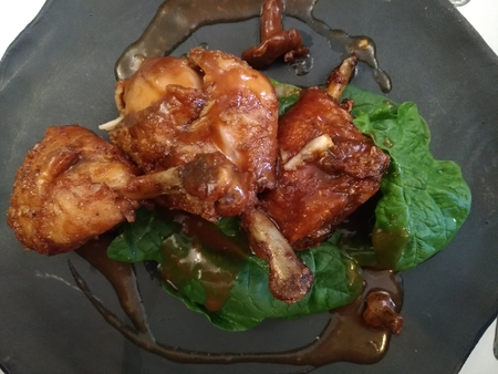roasted chicken on a plate, top view, meal close up