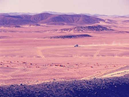 aerial view of Sachara desert mountains with auto riding, egypt Reklamní fotografie