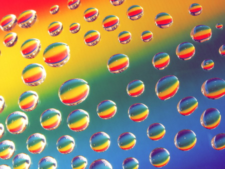 abstract background with drops of water against colorful background