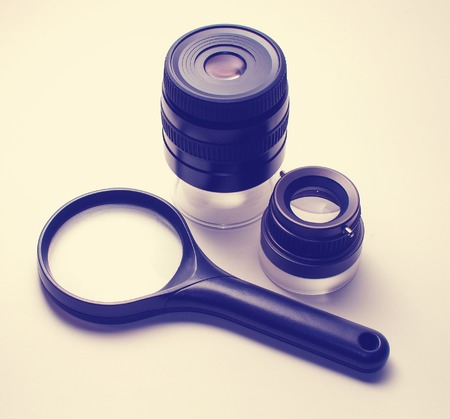 Different types of magnifying glasses: a one simple loupe, one with a doubly-convex lens, one with a constituent of several, and magnifier lens with a zoom effect. Objects isolated on white backround Reklamní fotografie