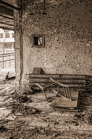 Pripyat town, abandoned territory left by people after the Chernobyl accident visible remnants of housing peeling paint abandoned furniture household items Reklamní fotografie - 116374272