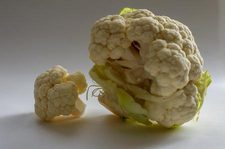fresh cauliflower on neutral background, isolated with smaller element Reklamní fotografie - 116374280