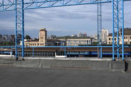 View of Kiev near the railway station. Railway tracks, clock tower, blue sky, summer Foto de archivo