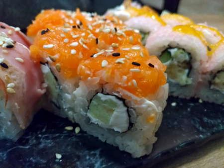 Close-up shot of sushi sliced on a plate, orange color, macro Foto de archivo