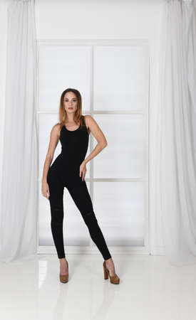 Womens figure in tight-fitting clothes, model pose Standard-Bild