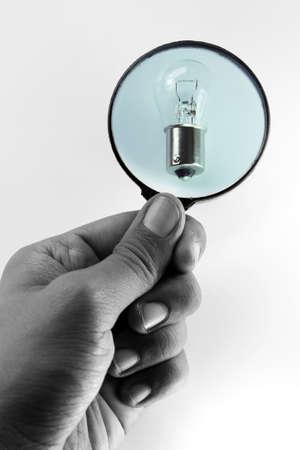Loupe focused on bulb lamp Stock Photo - 12847099