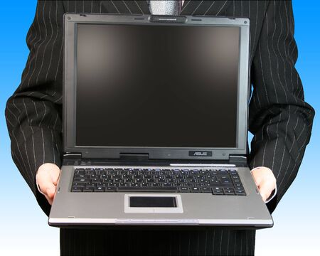 Businessman holding his laptop Stock Photo