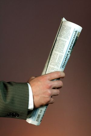 Businessman with newspaper photo