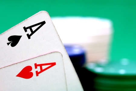 Aces and poker chips Stock Photo