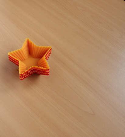 Form zum Backen von Cupcakes in Form eines Sterns Standard-Bild - 69921317