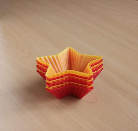 Form zum Backen von Cupcakes in Form eines Sterns Standard-Bild - 69921318