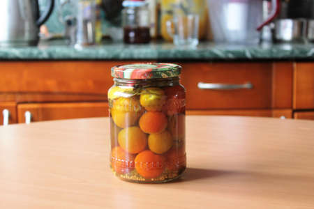 sterilized: tomatoes and garlic, canned are on the table Stock Photo