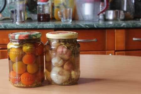 tomatoes and garlic, canned are on the table Stock Photo
