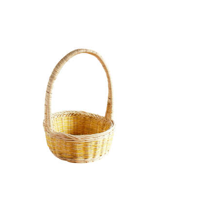 wicker basket for fruits isolated on white