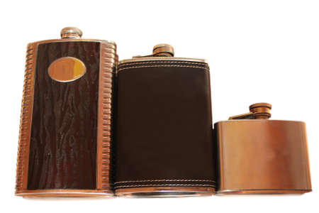 Three flat flask for alcohol in Golden tones isolated on white Standard-Bild