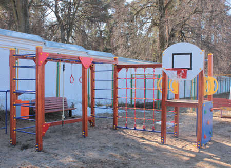 Children's basketball Hoop on the Playground on a bright Sunny day of spring