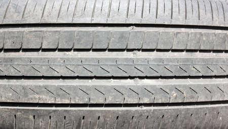 tread: deep tread all-season tires background cars close-up