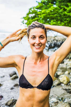Beautiful woman doing yoga in Costa rica, Central America 2015 LANG_EVOIMAGES