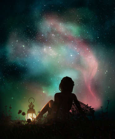 3d computer graphics of a fantasy scene with a girl who is sitting in the grass at night and watching the starry sky Foto de archivo