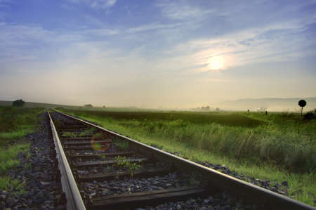 railroad track: Railway tracks in the middle of nowhere  HDR  Stock Photo
