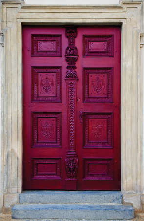 intricate: Old wooden door with intricate design and detail