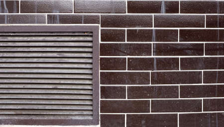 imitate: Wall with tiles that imitate real bricks.