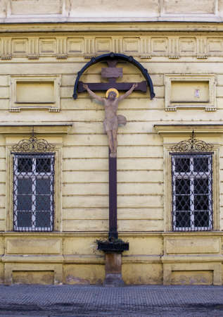 crucify: Crucifixion on a wall of a church Editorial
