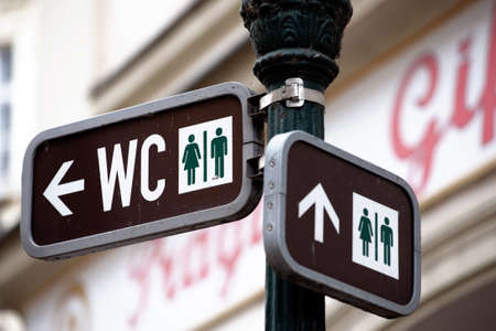 duo: Unisex toilet sign on a post Stock Photo