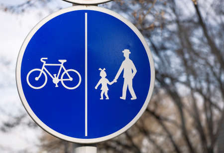 bycicle: Blue sign for a bycicle and pedestrian road