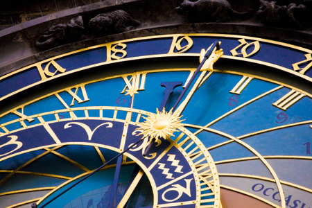 to face to face: Detail form the astronomical clock in Prague