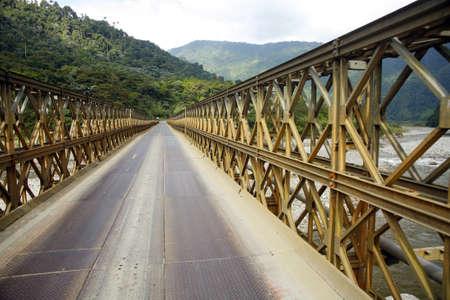 span: Bailey bridge crossing the Salado river in the Ecuadorian Amazon Stock Photo